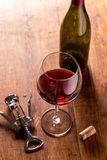 Red wine bottle, corks and corkscrew Royalty Free Stock Photos