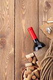 Red wine bottle, corks and corkscrew Stock Images