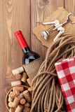 Red wine bottle, corks and corkscrew Stock Photos
