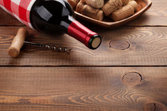 Red wine bottle, corks and corkscrew Royalty Free Stock Photo