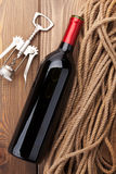 Red wine bottle and corkscrew Stock Image