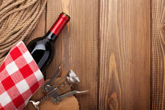 Red wine bottle and corkscrew Stock Photos