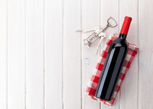 Red wine bottle and corkscrew Royalty Free Stock Images
