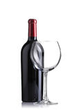 Red wine bottle and an empty glass Royalty Free Stock Image