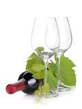 Red wine bottle and empty glasses Stock Photo