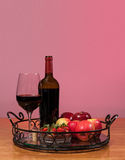 Red wine bottle and fruit with glass Stock Photo