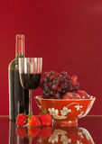 Red wine bottle and fruit with glass Stock Photography
