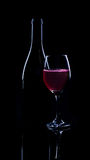 Red wine bottle and full glass Stock Image