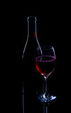 Red wine bottle and full glass Stock Photography