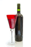 Red wine bottle with glass Royalty Free Stock Photography