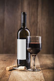 Red wine bottle and glass Stock Image