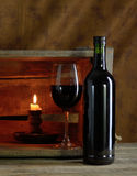 Red wine. A bottle and glass of red wine Stock Image