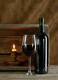 Red wine. A bottle and glass of red wine Royalty Free Stock Images