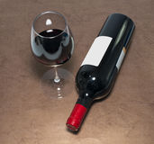 Red wine bottle and glass Royalty Free Stock Image