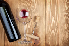 Red wine bottle glass and corkscrew Stock Images