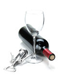Red wine bottle, glass and corkscrew Royalty Free Stock Photo
