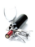 Red wine bottle, glass and corkscrew Stock Photo
