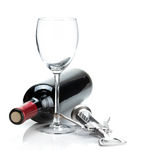 Red wine bottle, glass and corkscrew Royalty Free Stock Image