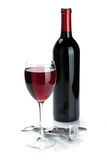 Red wine bottle, glass and corkscrew Royalty Free Stock Images