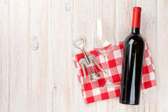 Red wine bottle, glass and corkscrew. On white wooden table background. Top view with copy space royalty free stock images