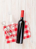 Red wine bottle, glass and corkscrew Stock Photos