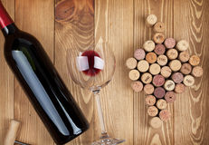 Red wine bottle glass and grape shaped corks Royalty Free Stock Photos