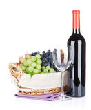 Red wine bottle, glass and grapes Stock Photos