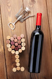 Red wine bottle, glass shaped corks and corkscrew. View from abo Stock Image