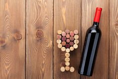 Red wine bottle and glass shaped corks Stock Photos