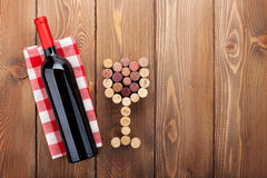 Red wine bottle and glass shaped corks Royalty Free Stock Photos