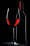 Red wine bottle and glass silhouette Royalty Free Stock Photo