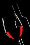 Red wine bottle and glass silhouette Stock Image