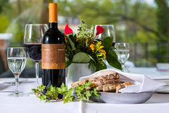 Red wine with bottle and glass on a table Stock Image