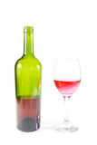Red Wine bottle and glass on white background Royalty Free Stock Photography