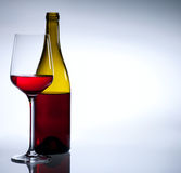 Red wine bottle and glass on white background Royalty Free Stock Photo