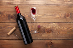 Red wine bottle, glass of wine and corkscrew Royalty Free Stock Photos