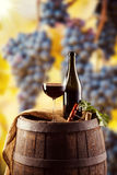 Red wine bottle and glass on wodden keg Stock Images