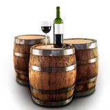 Red wine bottle and glass on a wooden barrel. Isolated on white, blank white label Stock Image