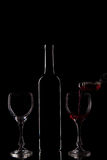Red wine - bottle and glasses Stock Photos