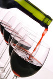 Red wine bottle and glasses. 5 glasses and a redwine-bottle Stock Images