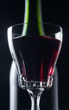 Red wine. Bottle and glasses with red wine on a black background Stock Photography