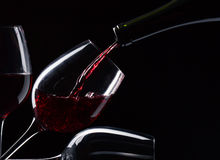 Red wine. Bottle and glasses with red wine on a black background Stock Photo