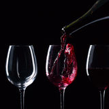 Red wine. Bottle and glasses with red wine on  black background Stock Image
