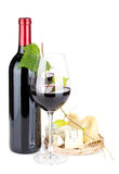 Red wine bottle, glasses and cheese Royalty Free Stock Images