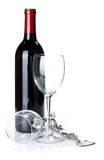 Red wine bottle, glasses and corkscrew Stock Photo