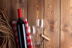 Red wine bottle, glasses and corkscrew Stock Image