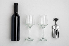 Red wine bottle, glasses and corkscrew over white background. Top view with copy space Royalty Free Stock Photo