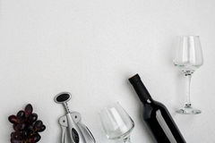Red wine bottle, glasses and corkscrew over white background. Top view with copy space Stock Photo