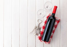 Red wine bottle, glasses and corkscrew Royalty Free Stock Photos