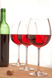 Red wine and bottle. Red wine glasses for the delicious royalty free stock photos